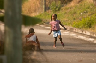 girl-playing-in-the-streets-of-la-gaulette-mauritius